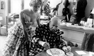 Brigitte Bardot watching Picasso paint.