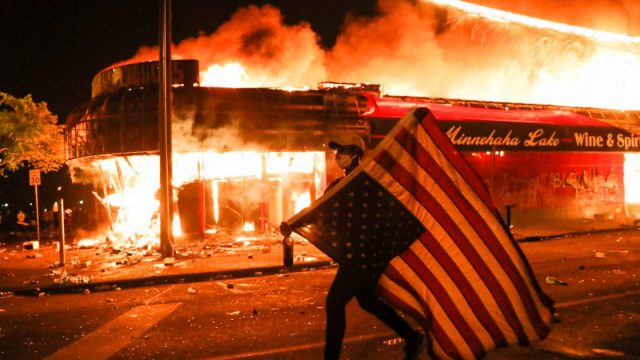 Image shows building on fire illustrating I Can't Breathe the corruptible seed