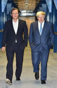 David Cameron and Boris Johnson walking together.